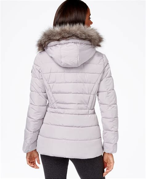 Calvin Klein Hooded Faux Fur Trim Quilted Puffer Coat by Calvin Klein Water Resistant Hooded Faux Fur Trimmed