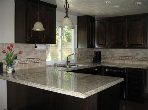 kitchens with dark brown cabinets dark brown cabinets and giallo santo granite counter tops