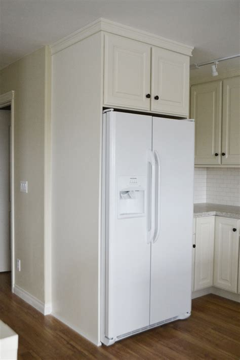 boxing  fridge  cabinetry momplex vanilla kitchen