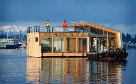 floating house floating houses that will convince you to trade ground for water