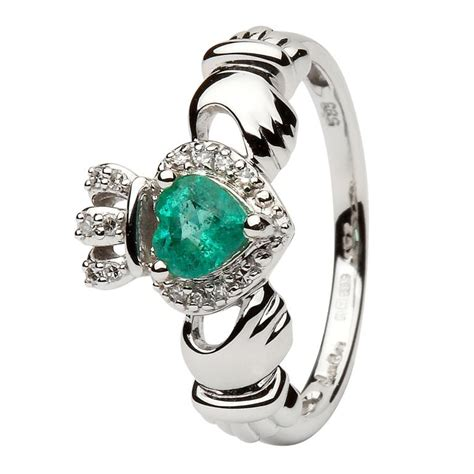 white gold claddagh ring set with emerald and