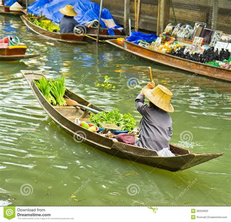 selling a boat selling food on a boat at floating market thailand