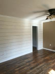 client remodel faux shiplap wall with larger 1 8 quot spacing and pergo max flooring in river road