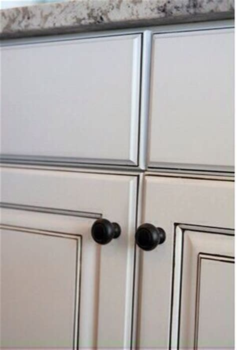 Cabinets painted Snowbound by Sherwin Williams then glazed