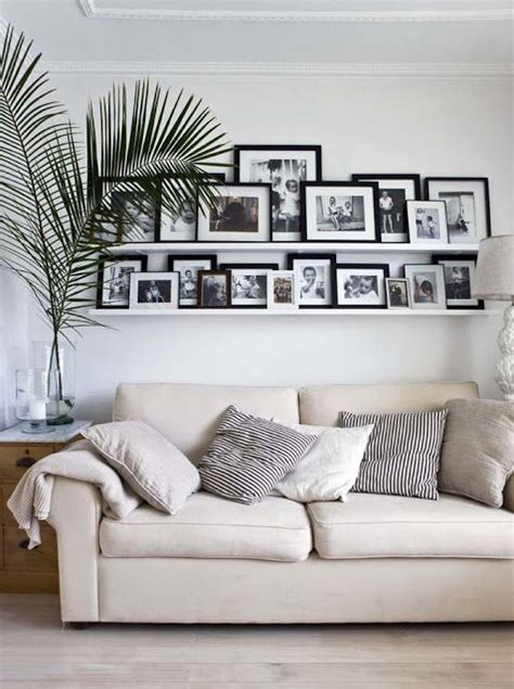 arranging pictures over sofa pinterest discover and save creative ideas
