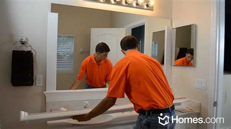 Bathroom Mirror Frame Ideas by Homes Com Diy Experts Share How To Frame A Quot Builder Grade
