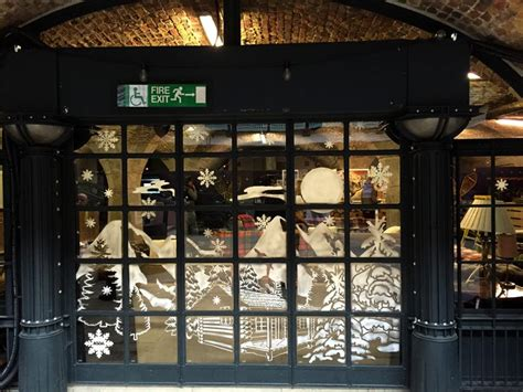graffiti life festive window display in snow spray