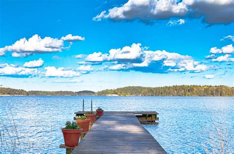 storybook wooden palace overlooking lake maelaren
