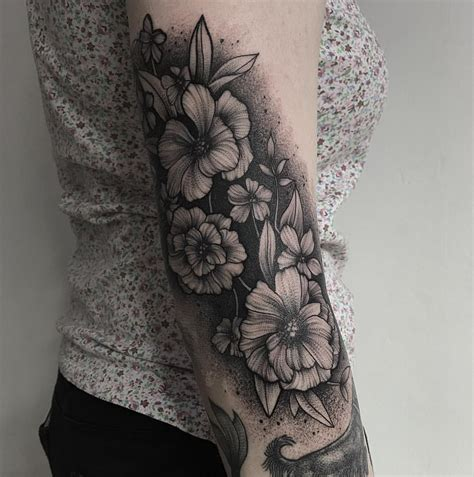 black flower tattoo by wpkorvis