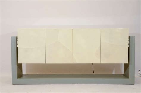 Floating Credenza faux parchment floating credenza at 1stdibs