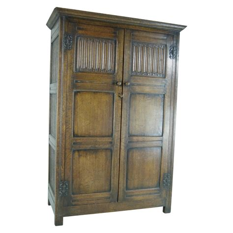antique armoire wardrobe closet b390 antique scottish two door linen fold oak panelled