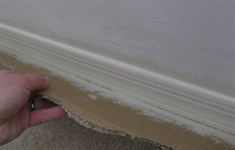 nj how do i paint baseboards without painting the carpet