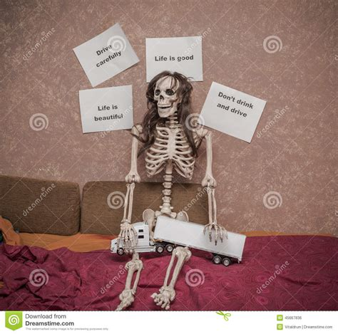 skeleton in bed skeleton in a wig sitting on the bed with truck and