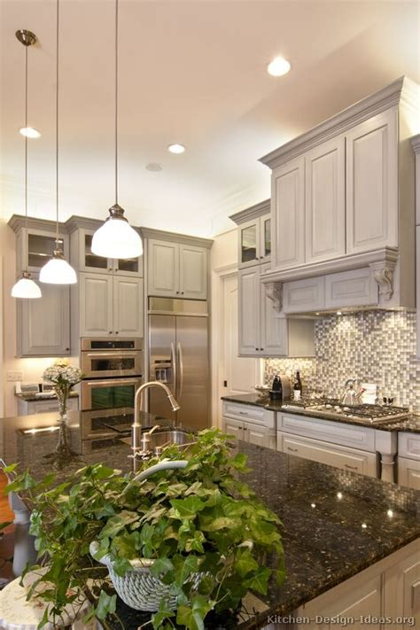 lovely kitchen lovely gray kitchen with island pendant lights a wood a glass tile backsplash and high