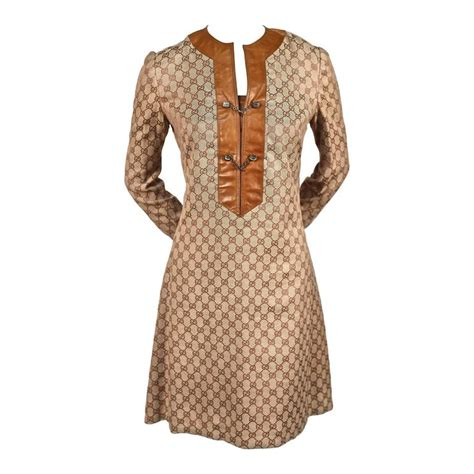 Gucci Tunik 1970 s gucci monogramed canvas tunic dress with leather trim for sale at 1stdibs