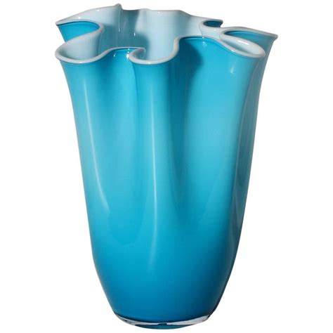 turquoise cased murano glass vase with white interior