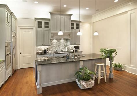 light gray cabinets with dark countertops choosing cabinet paint colors gray or creamy white