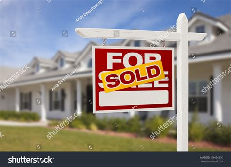 for sale sold real estate sign and new house stock photo