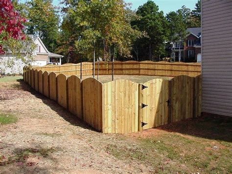 wood  scalloped privacy fence fence outdoor decor