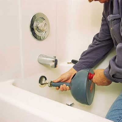 snake  tub drain access clog  overflow plate   clear  clogged drain   house