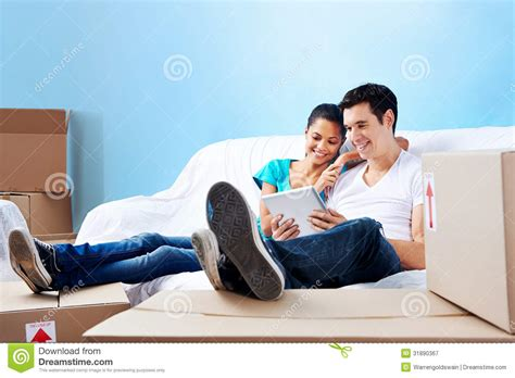 couple on couch couple on sofa moving royalty free stock photography