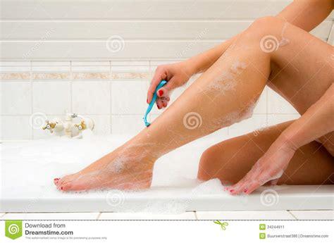 shaving in the bathtub shaving her legs stock image image 34244911