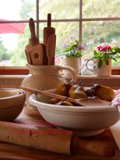 white ironstone bowl with antique rolling pins wooden
