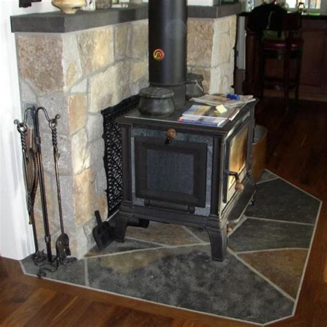 wood stove brick surround stove wood beam fireplace trim
