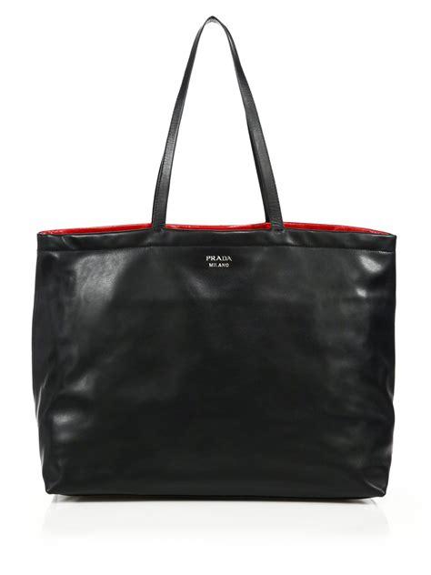 The Prada Calfskin Duffle Bag by Prada Reversible Soft Calf Tote Bag Prada Tessuto Bags