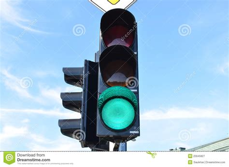 blue lights on traffic lights green color traffic light blue sky in background royalty