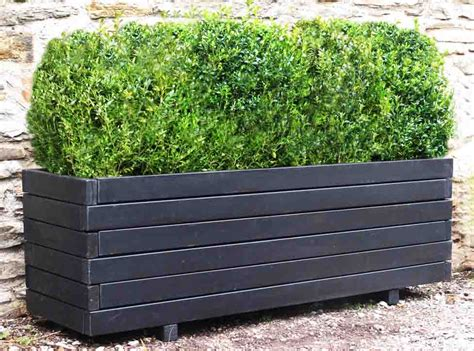 Planters Uk by Garden Planters Large Wooden Trough Planters 1 8m