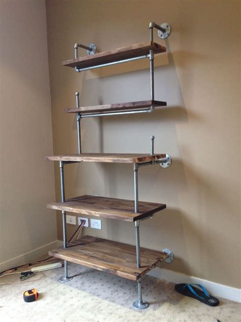 pin  industrial pipe shelves