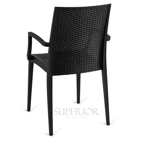 black wicker stacking chairs wicker look outdoor stackable plastic chair with arms in black