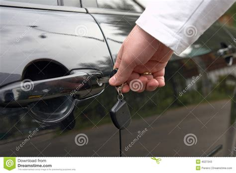unlock door key download man driver unlocking or locking man unlock car door by key stock photos image 4027343