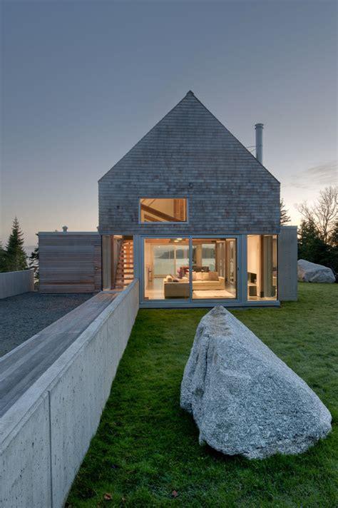 martin architects cedar shingles cascading down a modern courtyard house