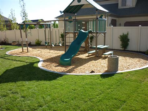 off backyard backyard playground in the landscaping in south jordan