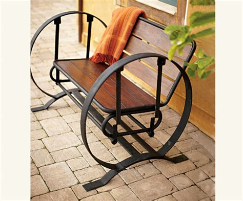 wagon wheel swing summer style wagon wheel glider popsugar home