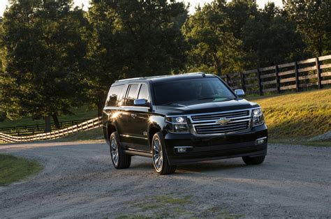 cadillac and chevrolet comparison chevrolet suburban suv 2016 vs cadillac