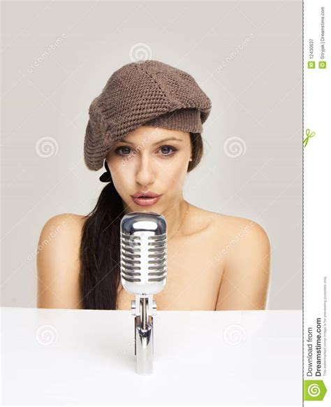 mics are for singing not swinging woman singing in retro mic royalty free stock photography