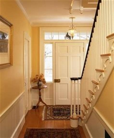 yellow foyer yellow hallways on banisters stairs and