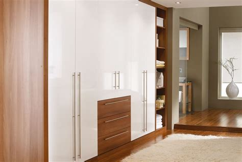 Sharps Fitted Bedroom Furniture Cosmopolitan In Light Walnut And White Http Www Sharps Co Uk Fitted Bedrooms Cosmopolitan