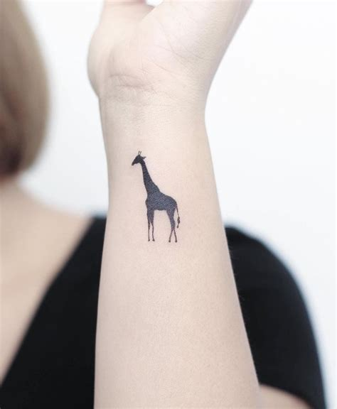 small giraffe tattoo 100 of the best small tattoos insider