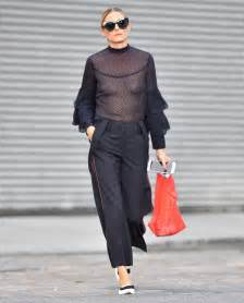 Olivia Palermo Wears Revealing Black Top While Walking in