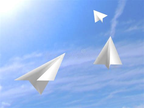 Origami Flying Plane - origami paper white airplanes flying on the sky stock