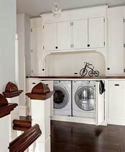 washer dryer cabinet 25 suggestions to hide a laundry area decor advisor