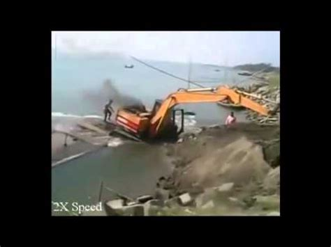 workers sink boat loading digger youtube - Excavator Sinking Boat