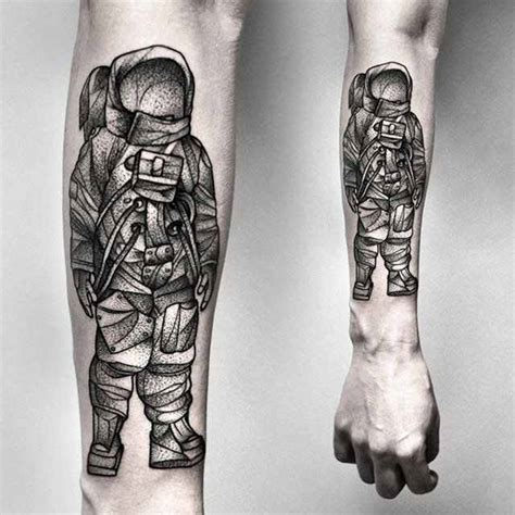 black astronaut tattoo by kamil czapiga design of