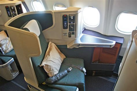 fly business class qatar cathay pacific emirates and