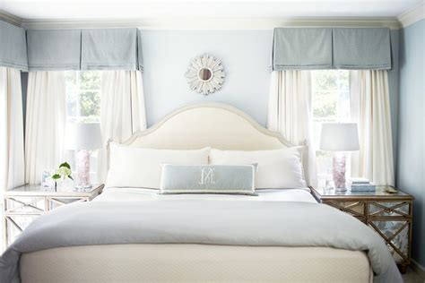 white bedroom with pink valance and curtains traditional beige and blue bedding bedroom traditional with light blue