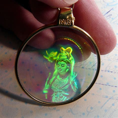 hologram pendant shiva or goddess depicted with 18k gp bail